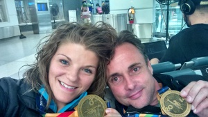 Sebastian and I, and our medals, at 2:45 am Monday morning. He made sure I got on the train safe!